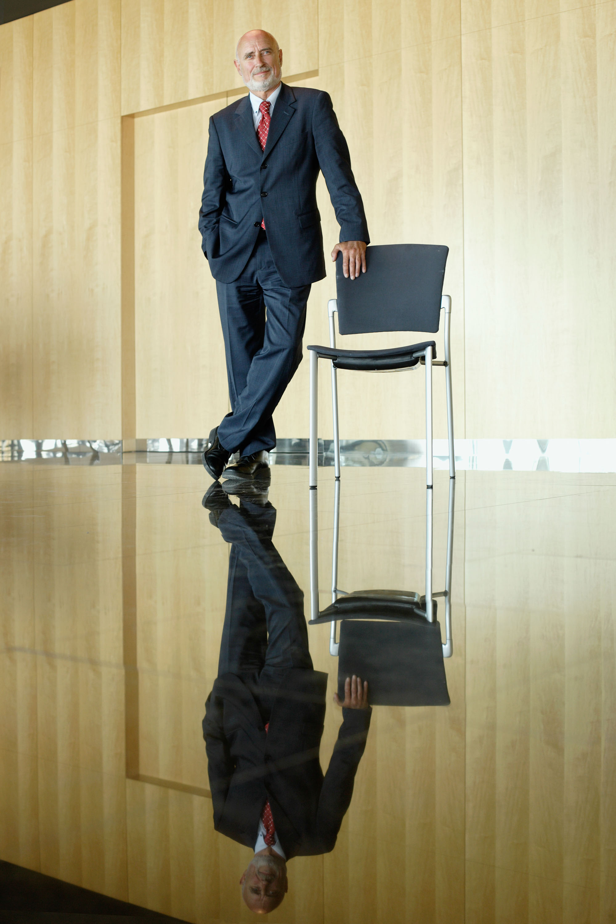 bussines man standing, with reflex on the floor